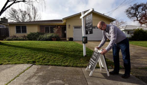 Preparing for an open house in 	 San Rafael, Calif. (Robert Tong/Marin Independent Journal)